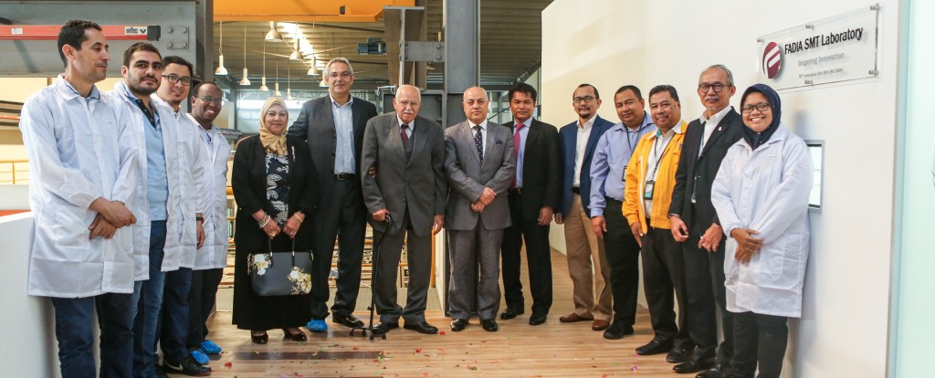 Guest of Honor,  Distinguished Guests, and Electronics Team Members in front of FADIA SMT Lab